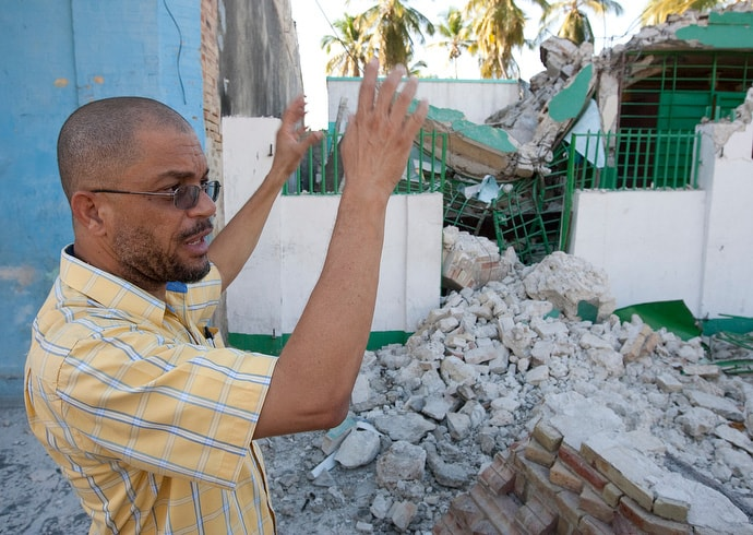 The Rev. Ralph Denizard of the Methodist Church of Haiti describes how a massive earthquake in January 2010 destroyed the Haiti Eye Clinic in Petit-Goâve, Haiti. United Methodist volunteer Jean Arnwine of Dallas died of injuries she received in the collapse. File photo by Mike DuBose, UM News.