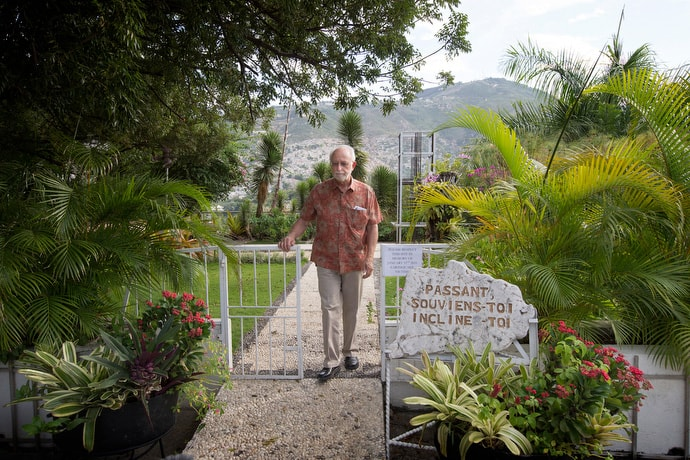 The Rev. James Gulley walks through a memorial garden in 2014 for those killed during the Haiti earthquake at the Hotel Montana in Port-au-Prince. Gulley survived the hotel's collapse, after being trapped for 55 hours beneath the rubble. The Revs. Sam Dixon and Clinton Rabb, who were trapped with Gulley, died of their injuries. File photo by Mike DuBose, UM News.