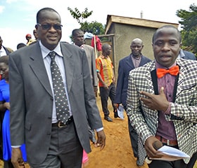 United Methodist deacon Joseph Zalambi, right, gives Bishop Daniel Wandabula of the East Africa Episcopal Area a tour of the new Magooli Academy for Children in Lugala, Uganda, at the school's dedication in September. Photo by Vivian Agaba, UM News.