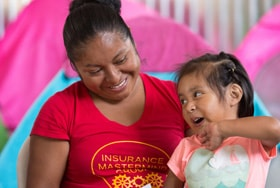 Miriam Magdalena Verdugo Lopez plays with her daughter Maria, 2, at the Movimiento Juventud 2000 shelter for migrants in Tijuana, Mexico. Photo by Mike DuBose, UM News.