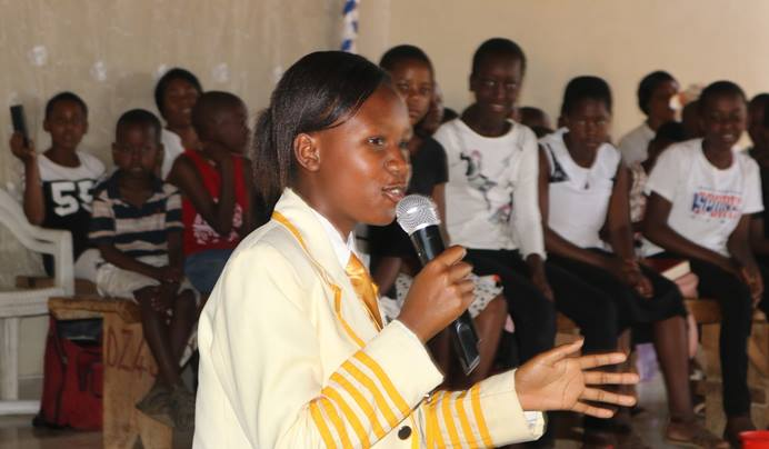 Teenager Melody Rudairo Nyamadzi, a junior Parliament representative and a member of the United Methodist Youth Fellowship, urges children to let their voices be heard during a special service led by the children's ministry at St. Dorcas United Methodist Church in Harare, Zimbabwe. Photo by the Rev. Taurai Emmanuel Maforo, UM News.