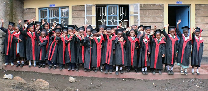 Students celebrate during graduation ceremonies at Dr. B.T. Cooper United Methodist School in Nairobi, Kenya. The majority of students at the school are Congolese children with refugee status. Photo by Gad Maiga, UM News.