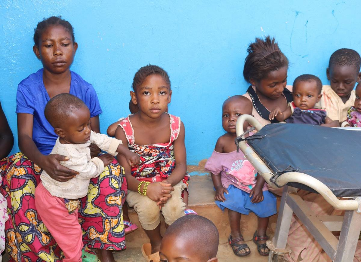 """Solange Cabwene (in blue shirt), a mother of two, brought her children to the United Methodist Irambo Health Center in Bukavu, Congo, for treatment for malnutrition. She joined The United Methodist Church's Vulnerable Association of Savings and Credit to help pay for her medical bills. """"This helped me because the association gave me a credit (loan) and today I start selling embers, and my two children (will) not relapse,"""" she said. Photo by Philippe Kituka Lolonga, UM News."""