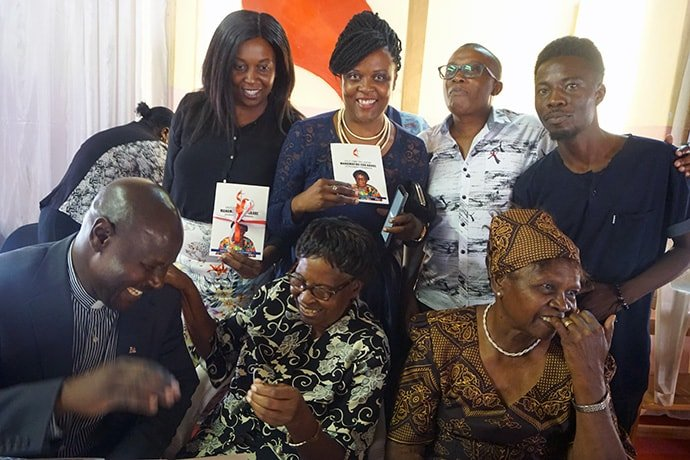 "Martha Mudzengerere (seated in center) enjoys a laugh with some of her grandchildren at a Nov. 10 event celebrating her new book, ""Old Time Religion."" The 104-year-old is one of the founding members of the Zimbabwe Episcopal Area's women's organization. Photo by Kudzai Chingwe, UM News."