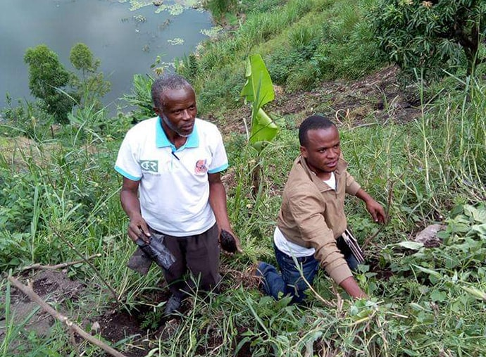 Agronomist Rachid Mutoro (right), a United Methodist in the Kivu Conference, helps a member of United Methodist Men tend to a new tree nursery the men have started in Goma, Congo. The men's group is planning to transfer the trees to United Methodist church land in the region. Photo by Philippe Kituka Lolonga, UM News.
