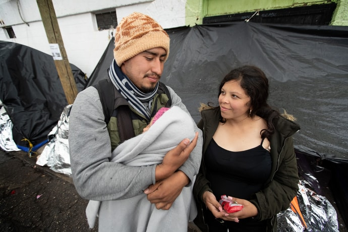 Jesús and his pregnant wife, Mariana, care for their 1-year-old daughter, Kataleya, at a tent camp in Juárez, Mexico, where they and dozens of other migrants are waiting for an appointment with U.S. immigration officials to request asylum in the U.S. The young family has been living in a two-person camping tent for two months. They are among some 16,000 asylum seekers who are stranded in Juárez following implementation of the Trump administration's Migrant Protection Protocols, which force asylum seekers to stay in Mexico while they wait for their immigration proceedings. Photo by Mike DuBose, UM News.