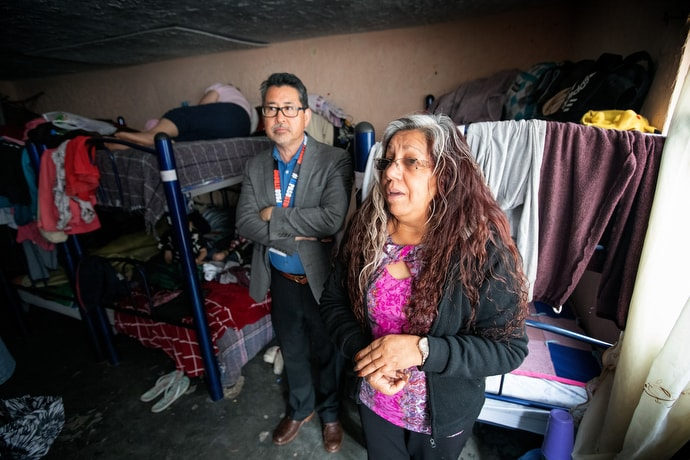 Dolores Fierro (right) offers a tour for members of the United Methodist Immigration Task Force of El Buen Samaritano, a shelter for migrants operated by the Methodist Church of Mexico in Juárez. At center is the Rev. John Oda, a member of the task force. Photo by Mike DuBose, UM News.