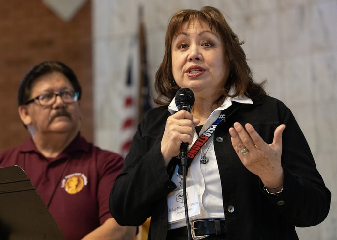 Bishop Minerva G. Carcaño addresses the United Methodist Immigration Summit meeting at Lydia Patterson Institute in El Paso, Texas. At left is the Rev. Santiago Heredia, who serves as chaplain at Lydia Patterson. Photo by Mike DuBose, UM News.