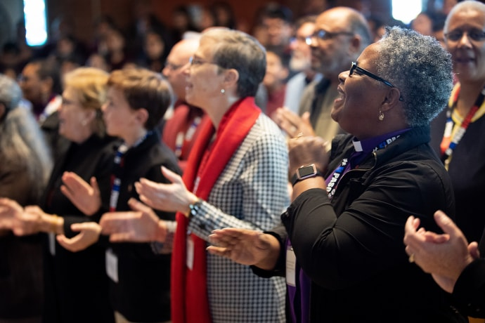 Bishop LaTrelle Easterling (right) sings alongside other members and guests of the United Methodist Immigration Task Force during worship service at the Lydia Patterson Institute in  El Paso, Texas. Photo by Mike DuBose, UM News.