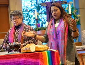The Revs. Martha E. Vink and Alka Lyall officiate at the Holy Communion service at the Advent Gathering organized by UM-Forward and Methodists in New Directions. The Dec. 3-4 gathering at St. Andrew United Methodist Church in Highlands Ranch, Colo., aimed to work toward a fully inclusive form of Methodism. Photo by Joy Butler, UM-Forward.