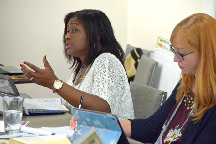 The Rev. Sharon Austin, Florida Conference director of Connectional and Justice Ministries, and Carla Works, professor at Wesley Theological Seminary, work on the Revised Social Principles during a writing session in Washington. Photo courtesy of United Methodist Board of Church and Society.