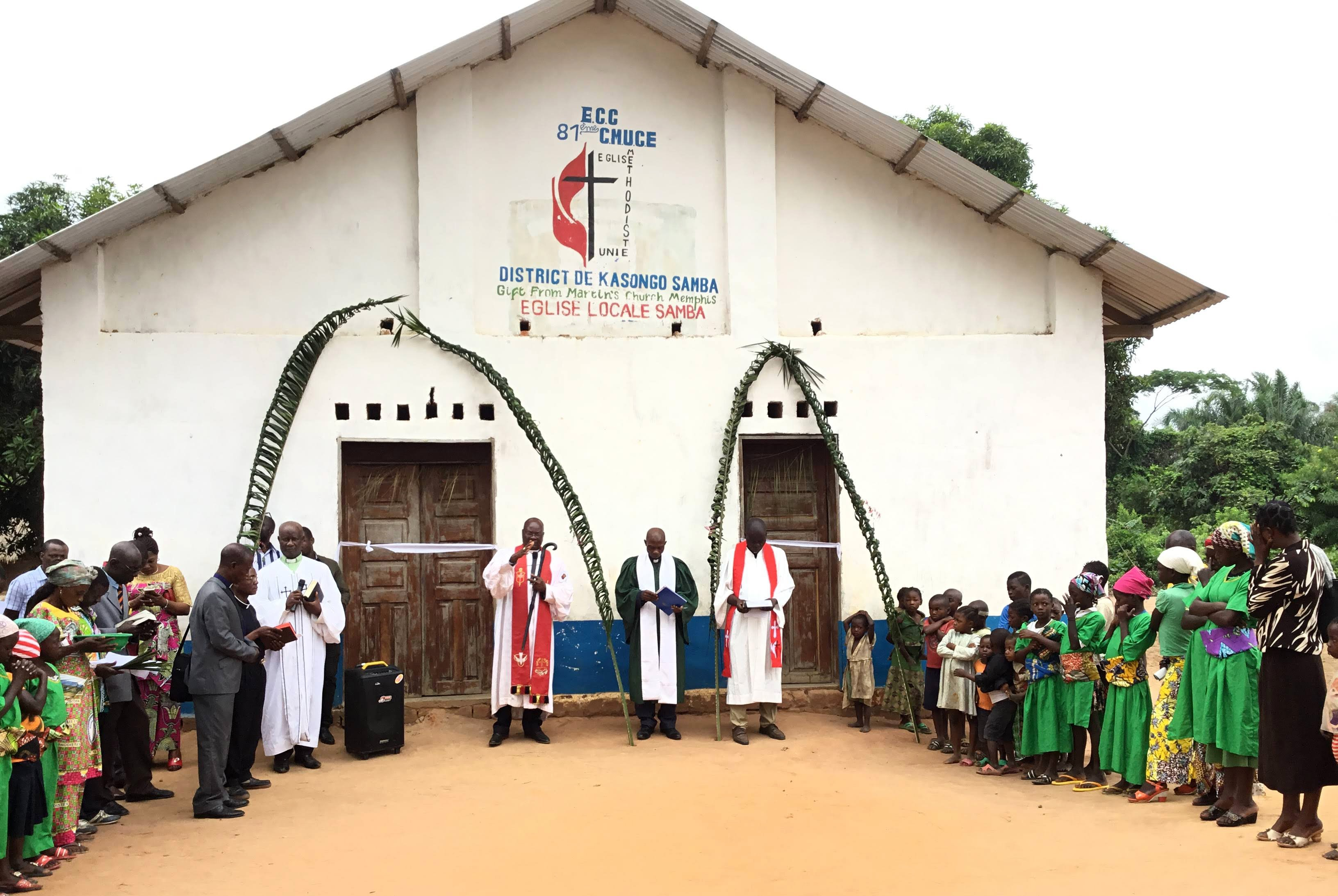 East Congo Bishop Gabriel Yemba Unda dedicates Samba United Methodist Church in the Kasongo-Samba District, which is nearly 250 miles from the bishop's office. During his 10-day trip, Unda dedicated more than 10 churches built with the help of United Methodist partnerships and local contributions. Photo by Judith Osongo Yanga, UM News.