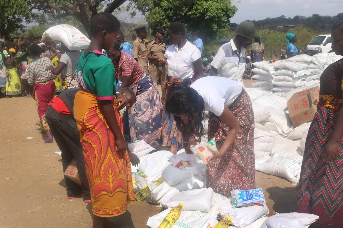 Disaster relief volunteers with The United Methodist Church in Malawi hand out supplies to Cyclone Idai survivors in the Ntcheu District. More than 1,000 households from seven villages received food, including maize flour, cooking oil, beans, sugar and salt. Many in the area lost their crops to flooding after the deadly March 14 storm. By Francis Nkhoma, UM News.