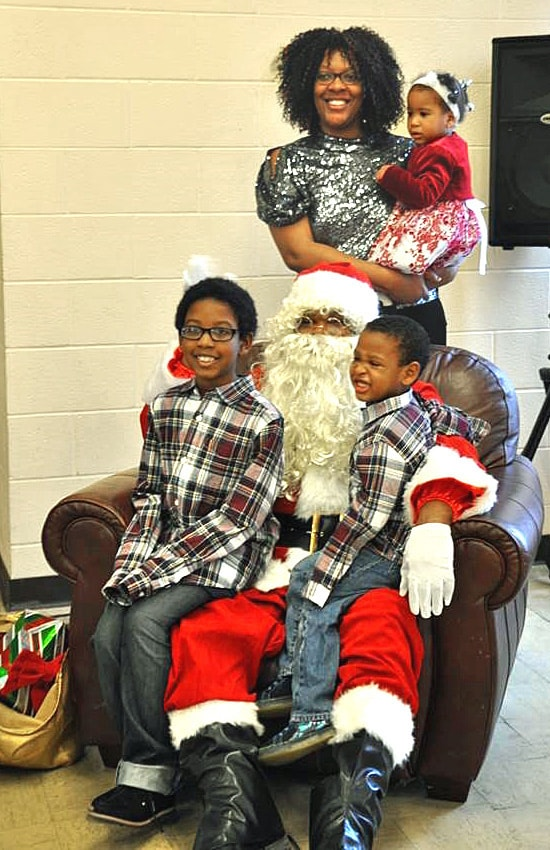 A family poses with Santa during a Christmas event at Garfield Memorial Church near Cleveland, Ohio. The multi-ethnic, multi-campus United Methodist church hosts different holiday events to share the joy of Christmas with its community. Photo courtesy of Garfield Memorial Church.