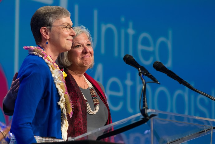 Dawn Wiggins Hare (right), top staff executive of the United Methodist Commission on the Status and Role of Women, becomes emotional as she and Harriett Jane Olson, United Methodist Women chief executive officer, lament the failure of two amendments to the church's constitution focused on equality in the church for women and girls during the United Methodist Women Assembly  2018 in Columbus, Ohio. File photo by Mike DuBose, UMNS.