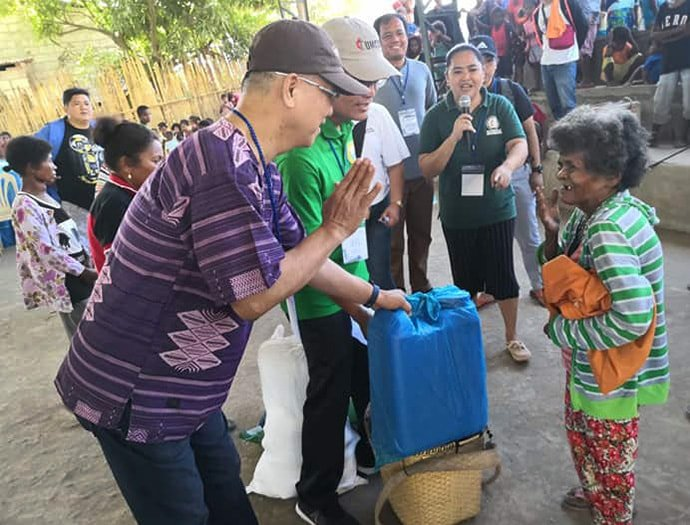 Manila Area Bishop Ciriaco Q. Francisco (left) and Jestril Alvarado, West Pampanga District superintendent, help distribute food to Aeta communities in Floridablanca in the Pampanga province of the Philippines. Holding the microphone is the Rev. Leslie Casupanan-Dela Cruz. The United Methodist Committee on Relief issued a $100,000 grant to provide support for 860 indigenous families affected by a deadly earthquake. Photo by the Rev. Gilbert Cedillo.