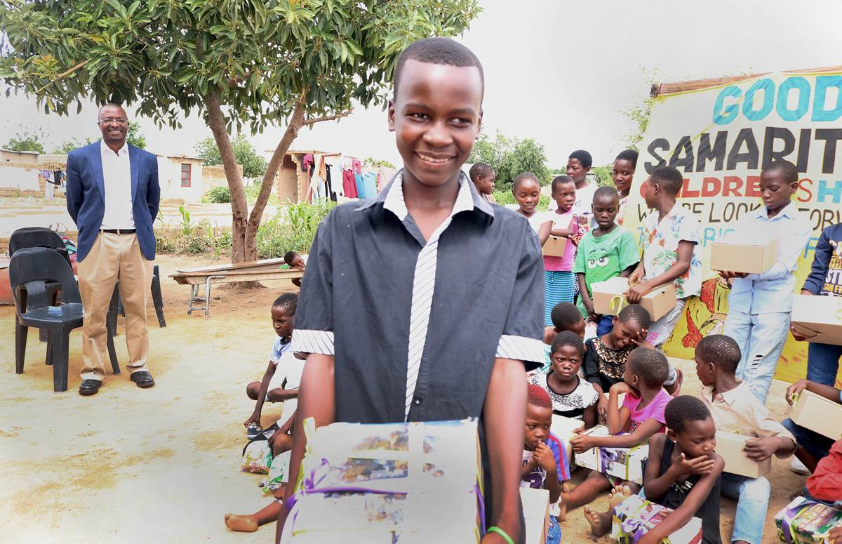 "Obert Chikwato shows off a gift he received from members of The United Methodist Church in Zimbabwe on Dec. 13. ""This is my first time to get a Christmas gift,"" said the 16-year-old, who lives at Good Samaritan Children's Home, a foster home in Harare, Zimbabwe. Photo by Priscilla Muzerengwa, UM News."