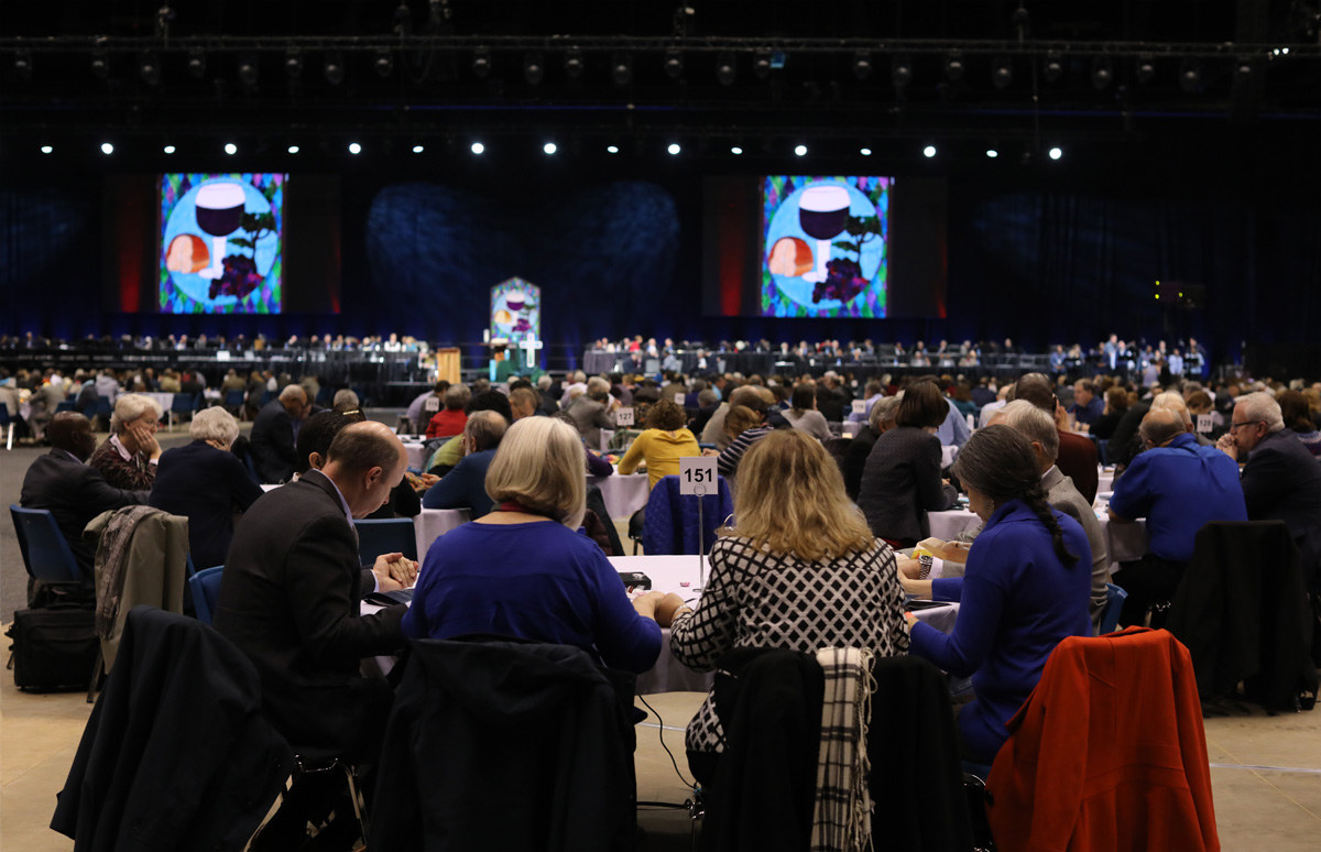 Delegates pause for prayer at the 2019 special General Conference in St. Louis. A group of 2020 General Conference delegates and other church leaders from Africa, Europe and the Philippines is proposing a new form of unity. File photo by Kathleen Barry, UM News.