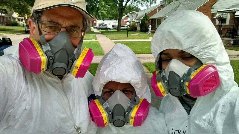 Volunteers wearing protective gear gather to help homeowners in Detroit who were hit by floods in 2014. From left are Lawrence Matthews of the Mennonite Disaster Service, Cheryl Tipton, disaster case manager with the Northwest Detroit Flood Recovery Project of The United Methodist Church and Andrew Massey, 15, of St. Paul's United Methodist Church in Detroit. Photo courtesy of the Northwest Detroit Flood Recovery Project.