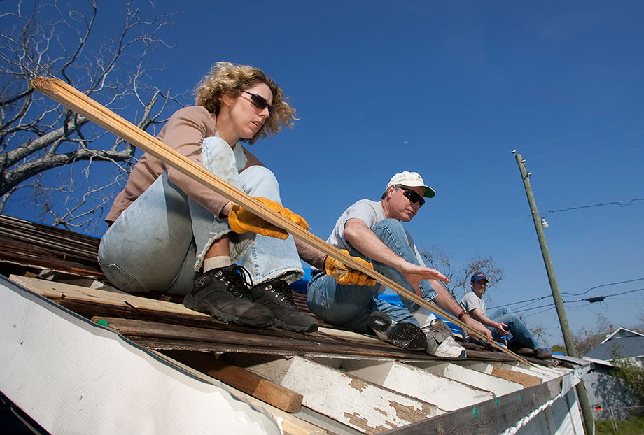 Volunteers from Christ Church United Methodist in New York repair a roof damaged by winds from Hurricane Katrina in Biloxi, Miss., in 2006. From left are Marsha Askins, the Rev. Richard Allen and Chris Andrews. Collaborative relationships established between faith-based, secular and governmental groups in the recovery from Hurricane Katrina have changed the face of local disaster response, relief officials said. File photo by Mike DuBose, UMNS.