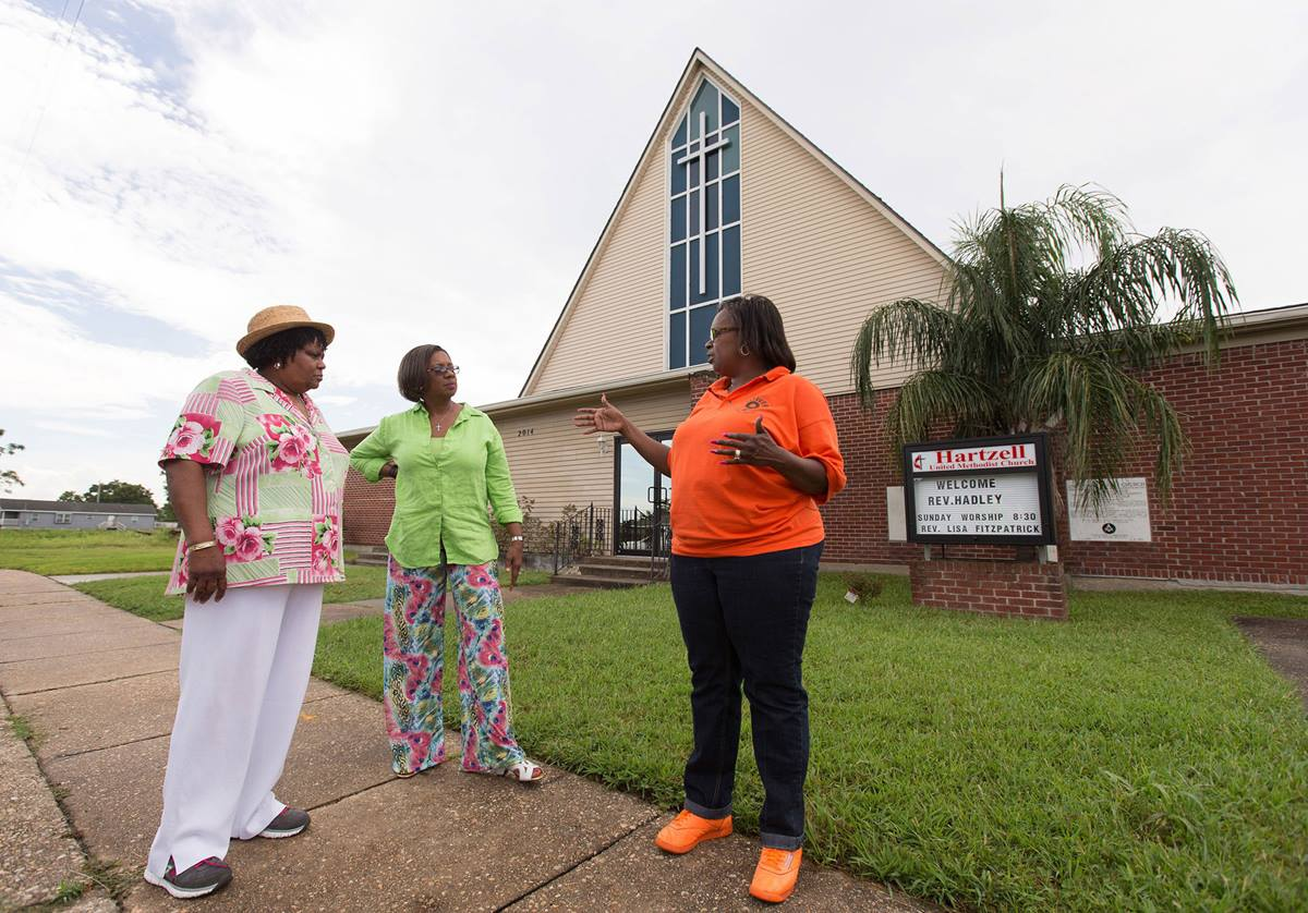 Church members discuss the progress of recovery in the area around Hartzell United Methodist Church in New Orleans' Lower 9th Ward, which was flooded by Hurricane Katrina in 2005. From left are Burnetta D. Fauria, Angelique White-Williams and Andrea Sanchez-Reese. Photo by Mike DuBose, UMNS.
