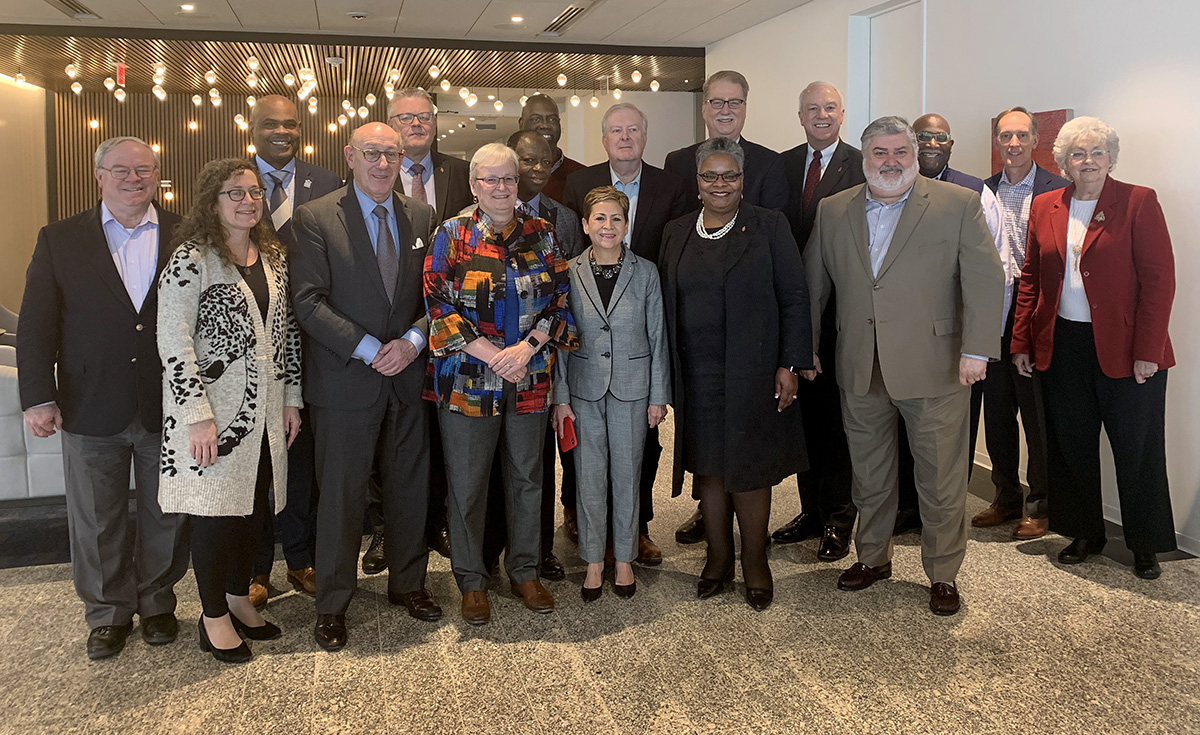 Members of a diverse group of bishops and other United Methodist leaders gather for a group photo in Washington after reaching agreement on a proposal that would maintain The United Methodist Church but allow traditionalist congregations to separate into a new denomination. Photo courtesy of the Mediation Team.