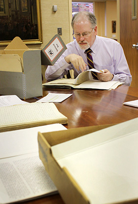 L. Dale Patterson studies papers from the archives at the United Methodist Commission on Archives and History at Drew University in Madison, New Jersey. A 2010 file photo by Kathleen Barry, UM News.