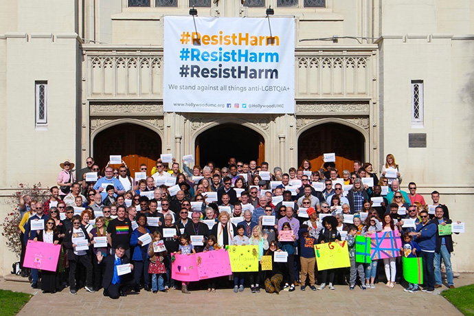 "Members of Hollywood United Methodist Church in Los Angeles display their support for the Resist Harm effort, which opposes the Traditional Plan that strengthens the bans on same-sex weddings and ""self-avowed practicing"" gay clergy. Photo courtesy of Hollywood United Methodist Church."