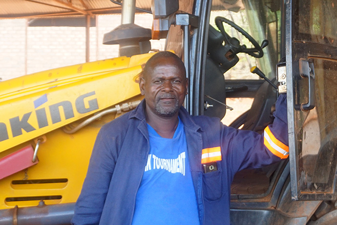 Vusumuzi Ndlovu works as a construction supervisor and machine operator at Pagejo Rarubi Farm in rural Zimbabwe. He said he turned his life around when he became a member of The United Methodist Church in 2007. He's now actively involved in the farm church's men's organization. Photo by Kudzai Chingwe, UM News.