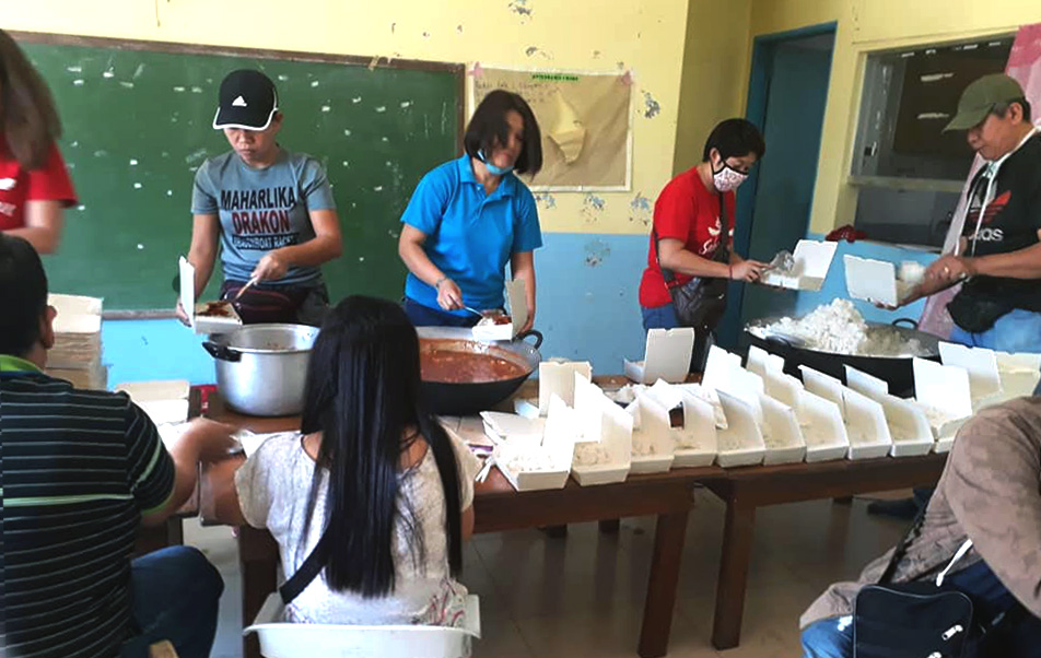 A team from the United Methodist Asuncion Perez Memorial Center in the Mataas Na Kahoy province of Batanga, Philippines, prepares food for relief distribution after the Taal volcano erupted on Luzon Island Jan. 12, leaving an estimated 282,000 people displaced. Photo courtesy of Liza A. Cortez.