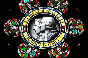 A stained-glass window featuring John and Charles Wesley is found at the Wesley Memorial Methodist Church in Epworth, England. Photo by Kathleen Barry, United Methodist Communications.