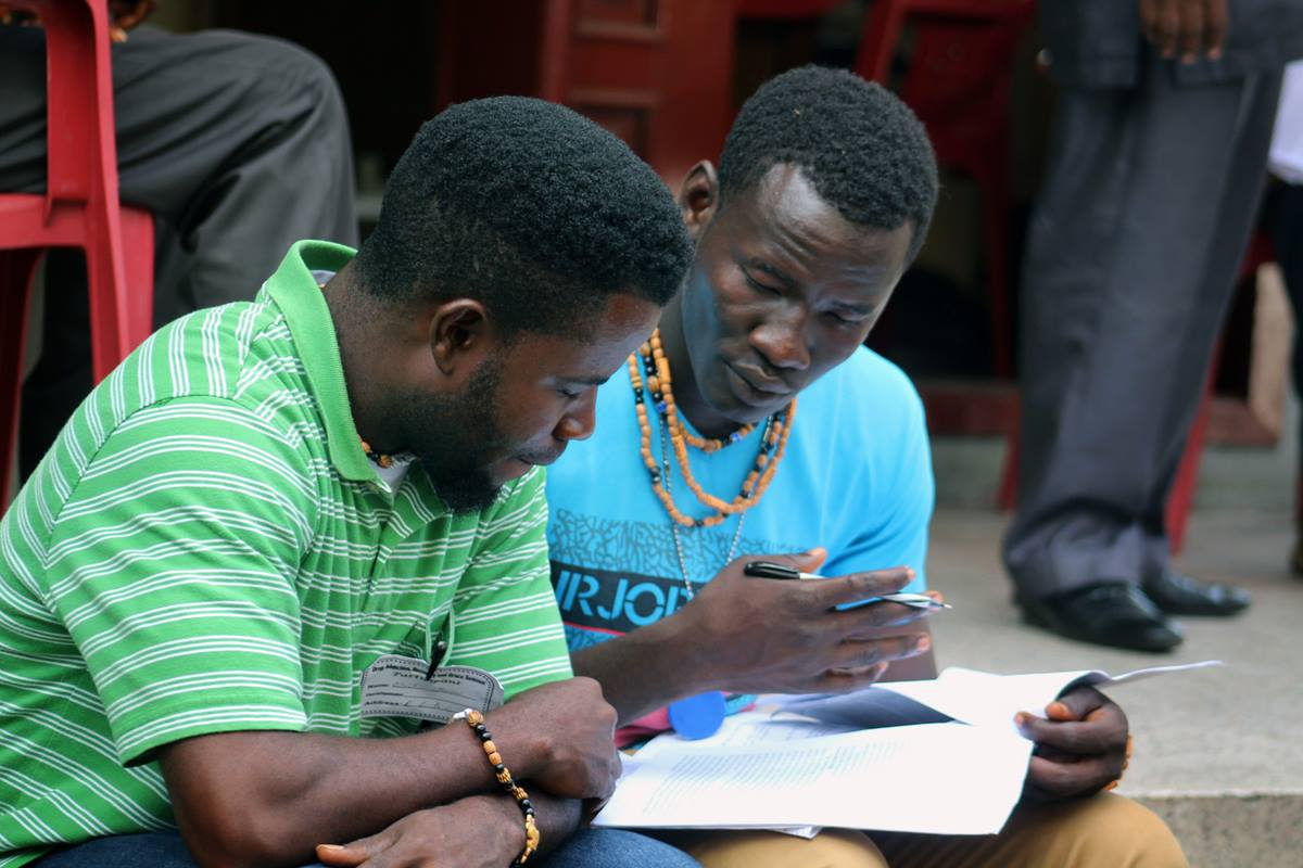 Eric Nyenow (left) and Emmanuel Gbuie, residents of the United Methodist New Life Recovery Center, review their notes during an addiction and substance abuse seminar in Monrovia, Liberia. The United Methodist Church in Liberia hosted the seminar to help local churches expand and strengthen their recovery ministries. Photo by E Julu Swen, UM News.