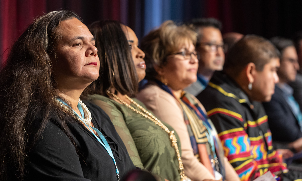 Monalisa Tuitahi, executive director of the Pacific Islander Ministry Plan, and other representatives of The United Methodist Church's ethnic initiatives watch a video on the work of the initiatives during the 2020 Pre-General Conference Briefing in Nashville, Tenn. Photo by Mike DuBose, UM News.