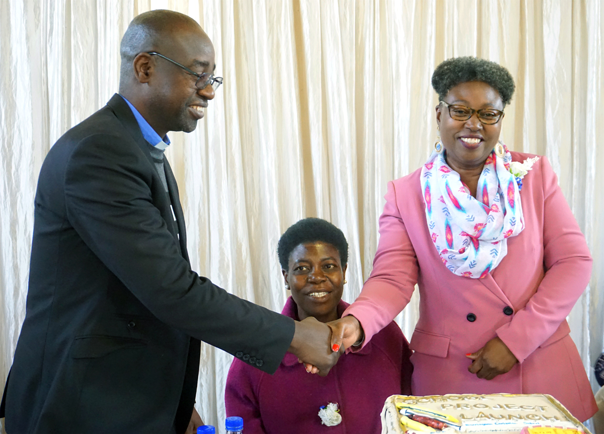The Rev. Henry Luckson Chareka (left) congratulates guest of honor Mwazvita Patricia Katsidzira-Madondo, during the launch of United Methodist Barrington Christian School in Harare, Zimbabwe. Joyce Chikuni (center), board chairperson of the school, watches. The school will be the first private United Methodist institution in the urban part of Harare and the first to be run by United Methodist women. Photo by Kudzai Chingwe, UM News.
