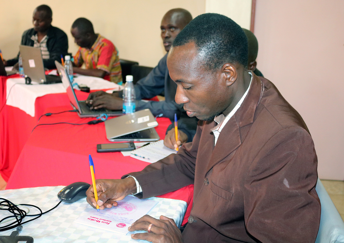 The Rev. Danson Maganga from Tanzania takes notes during a United Methodist e-Academy weeklong training session in Nairobi, Kenya. The goal of the new e-learning program is to equip people for ordained and lay leadership in rural communities. Photo by Gad Maiga, UM News.