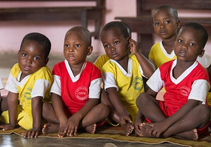 Children listen to a vocabulary lesson at the Bethlehem Day Care Center in Youhoulil, Côte d'Ivoire. The United Methodist Women's organization in the Dabou District started the program in 2016 to help provide nutrition and education for the children of local farmers.