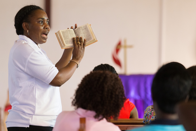 Francine Mpanga Mufuk leads a Bible study on Psalm 91 with young women at Nazareth United Methodist Church. Mpanga Mufuk, a United Methodist missionary, leads the conference's work with young girls and women in discipleship, counseling, mentoring and relationship building. She is a graduate of United Methodist Africa University. Photo by Mike DuBose, UMNS.