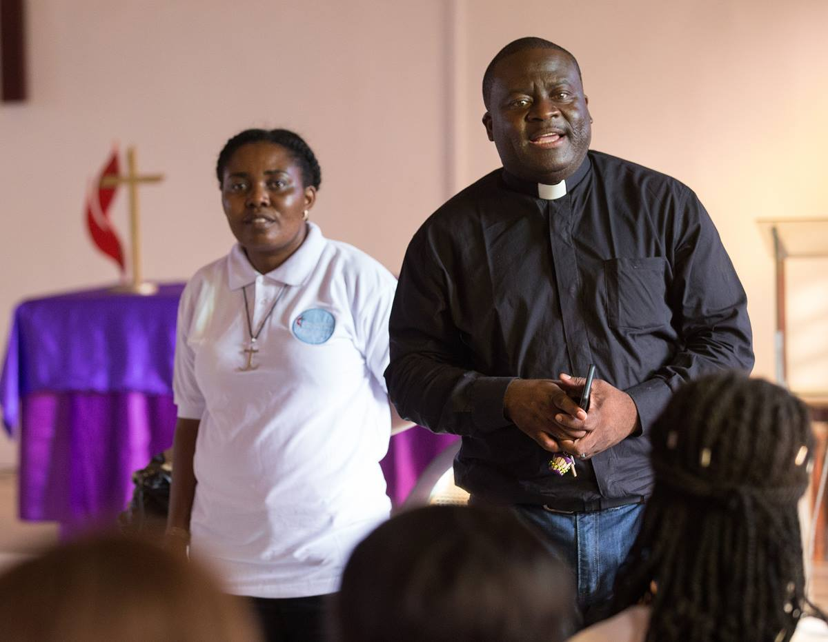 United Methodist missionaries Francine Mpanga Mufuk (left) and the Rev. Jean Claude Masuka Maleka lead a Bible study at Nazareth United Methodist Church in Abidjan, Côte d'Ivoire. The married couple are both from the Democratic Republic of Congo.