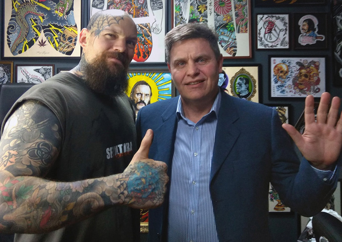 The Rev. Lev Shults (right), pastor of the Russian-speaking Agape United Methodist Church in Prague, visits a tattoo parlor. Shults believes you cannot always wait for people to come to church, the church needs to also go to the people. Photo by Urs Schweizer, Central Conference of Central and Southern Europe.