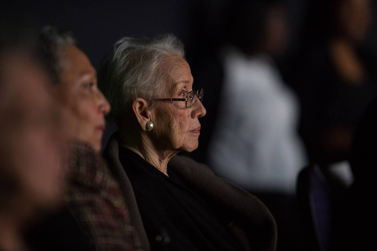 "NASA ""human computer"" Katherine Johnson watches the premiere of the movie ""Hidden Figures"" at the Virginia Air and Space Center in Hampton, Va., in December, 2016. Johnson, who calculated flight trajectories for John Glenn's first orbital flight in 1962, attended St. James Methodist Church in White Sulphur Springs, W.Va., as a child. Photo by Aubrey Gemignani, NASA."