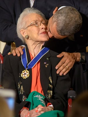 President Barack Obama kisses former NASA mathematician Katherine Johnson after presenting her with the Presidential Medal of Freedom in November 2015, during a ceremony at the White House. Photo by Bill Ingalls, NASA.