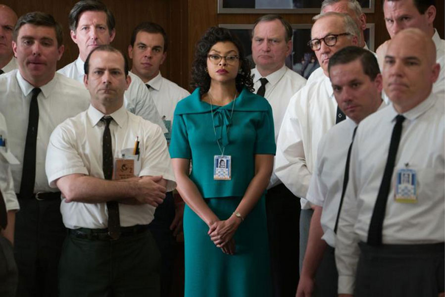 "In this scene from ""Hidden Figures,"" Taraji P. Henson in her role as Katherine G. Johnson stands out amid her team of fellow mathematicians that helped send into orbit John Glenn. Photo by Hopper Stone, ""Hidden Figures"" (20th Century Fox)."