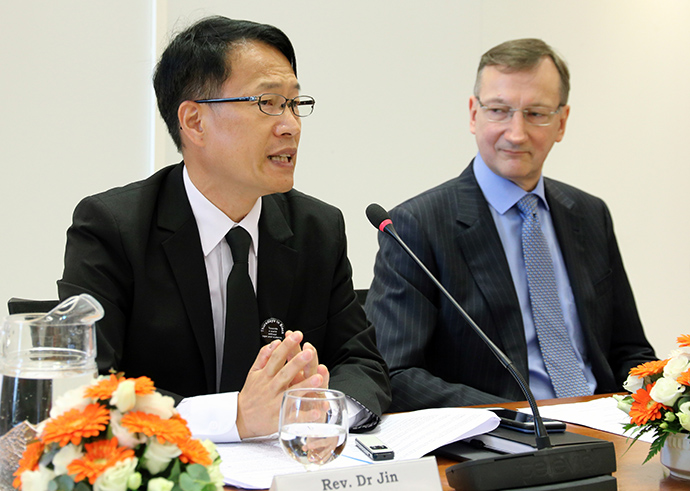The Rev. Jin Yang Kim (left) speaks during the World Council of Churches live-stream event held Feb. 6, 2020. Looking on is Peter Prove, director of the Commission of the Churches on International Affairs.  Photo by Ivars Kupcis, World Council of Churches.