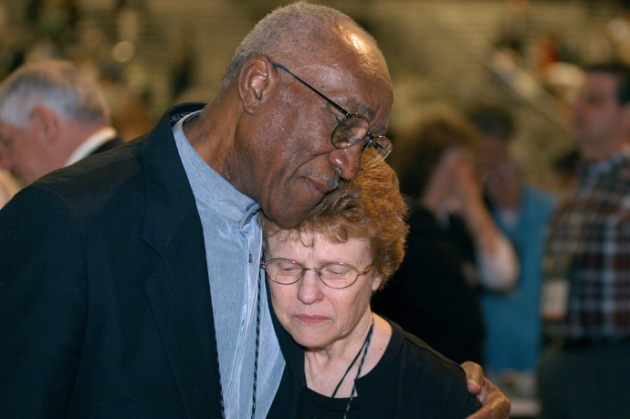 Delegates Burnham A. Robinson (left) and Judith A. Sands embrace following a vote affirming unity in the United Methodist Church at the close of the denomination's 2004 General Conference in Pittsburgh. Talk before the upcoming 2020 General Conference in Minneapolis is about dividing the church. File photo by John C. Goodwin, UM News.