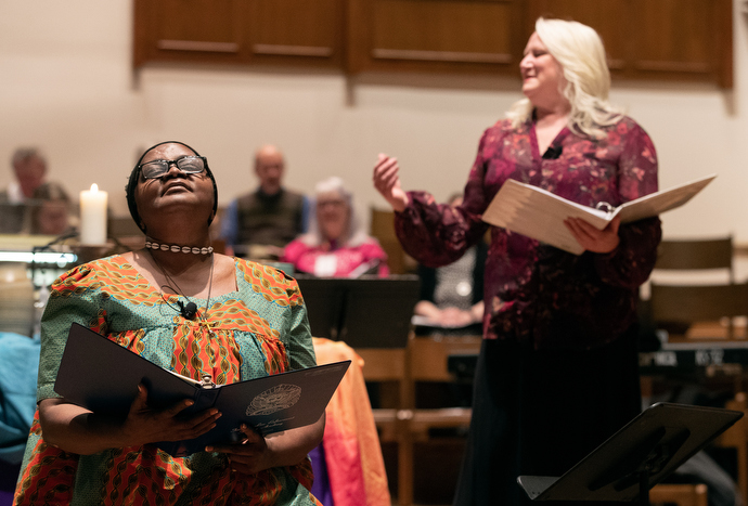 The Rev. Grace Imathiu (left) and Marcia McFee lead opening worship for the Connection 2020 gathering sponsored by Reconciling Ministries Network at Belmont United Methodist Church in Nashville, Tenn. Photo by Mike DuBose, UM News.
