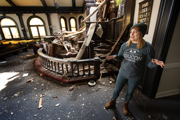 Kylan Hadley describes tornado damage to East End United Methodist Church in Nashville, Tenn. Hadley is the church's youth director. Photo by Mike DuBose, UM News.