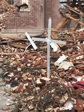 A cross stands amid rubble at Dodson Chapel United Methodist Church in Hermitage, Tenn. The church was devastated by storms in Nashville and central Tennessee on March 3. Photo by the Rev. Chris Seifert.