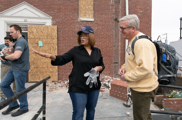 The Rev. Sheila Peters of Braden Memorial United Methodist Church in Nashville, Tenn., shows the Rev. Paul Purdue of Belmont United Methodist Church in Nashville where a volunteer team from Belmont could begin helping clear tornado debris from in front of the church. Photo by Mike DuBose, UM News.