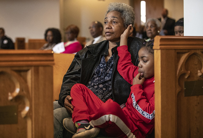 Renee Featherston from Braden Memorial United Methodist Church attends worship with her great-great niece, 6-year-old Caliyah Crenshaw, at Gordon Memorial United Methodist Church in Nashville, Tenn. The churches worshiped together at Gordon on the Sunday following the March 3 tornado that heavily damaged the Braden Memorial. Photo by Kathleen Barry, UM News.