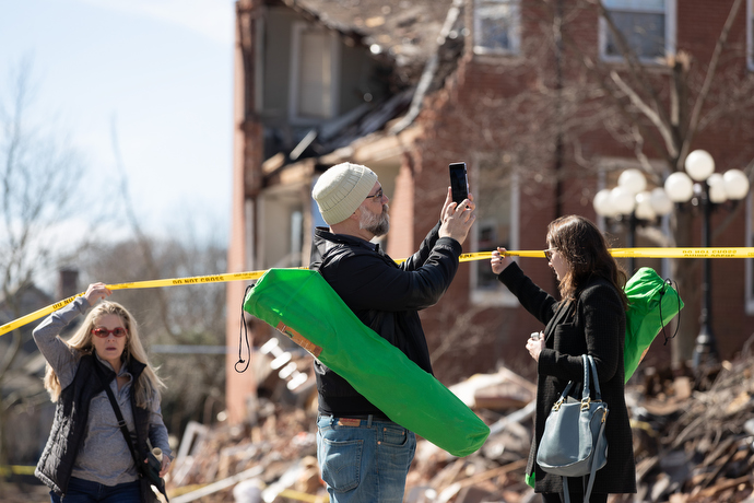 Craig Brewer (center) and Jamie Rosengard (right) view damage to East End United Methodist Church in Nashville, Tenn., following an outdoor worship service in the adjacent park. The church building was heavily damaged in a March 3 tornado. Photo by Mike DuBose, UM News.
